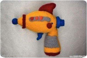 Pistolet à eau en crochet